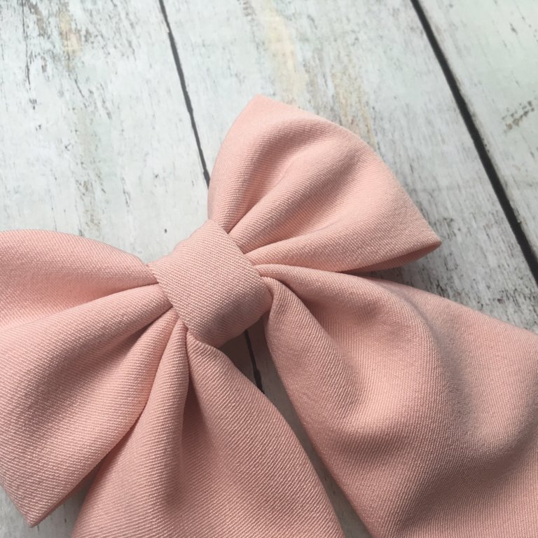 Maigi rozā tauriņš