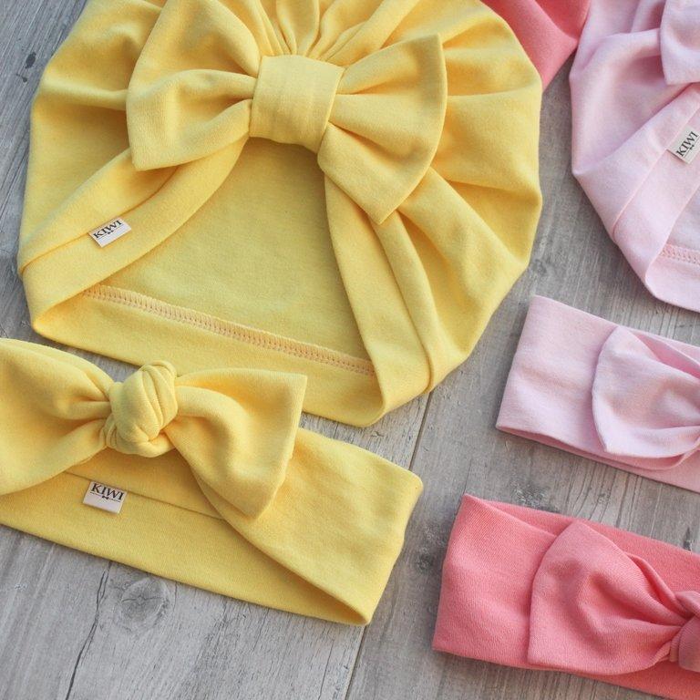Rozā un dzeltenas matu bantes