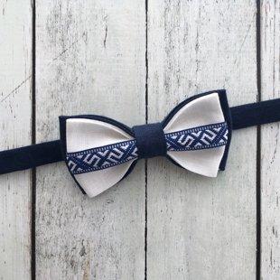 Zils lina tauriņš ar Jumja zīmes lentīti