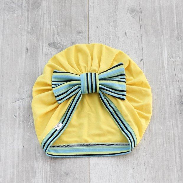 Dzeltena turbāncepure ar svītrainu banti